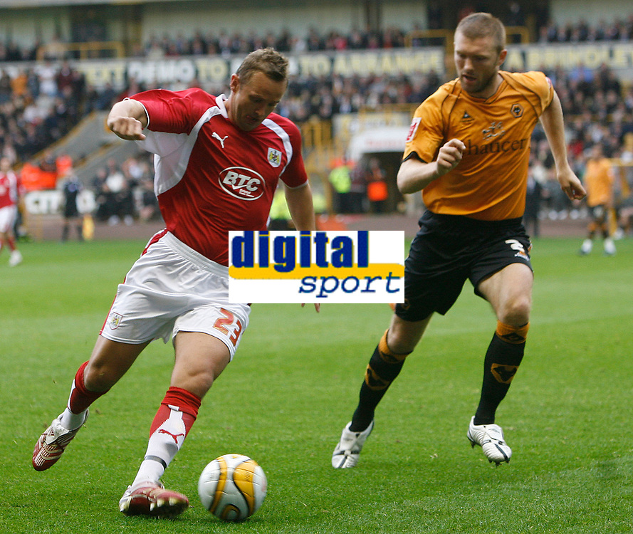Photo: Steve Bond/Sportsbeat Images.<br />Wolverhampton Wanderers v Bristol City. Coca Cola Championship. 03/11/2007. Lee Trundle (L) controls the ball as Neill Collins (R) closes in