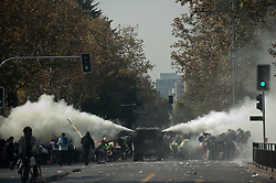 Riot police fire water cannon at protesting students in a march in Santiago, capital of Chile, on April 16, 2015. The march was held to demand the government fulfill its promise of free higer education, according to the organizers. EXPA Pictures © 2015, PhotoCredit: EXPA/ Photoshot/ [e]JORGE VILLEGAS<br /> <br /> *****ATTENTION - for AUT, SLO, CRO, SRB, BIH, MAZ only*****