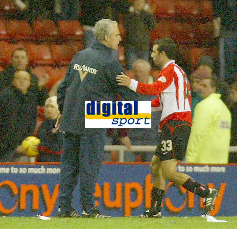 Photo. Andrew Unwin.<br /> Sunderland v Nottingham Forest, Nationwide League Division One, Stadium of Light, Sunderland 10/01/2004.<br /> Sunderland's goalscorer, Julio Arca (r), is congratulated by his team's manager, Mick McCarthy (l), at the end of the game.