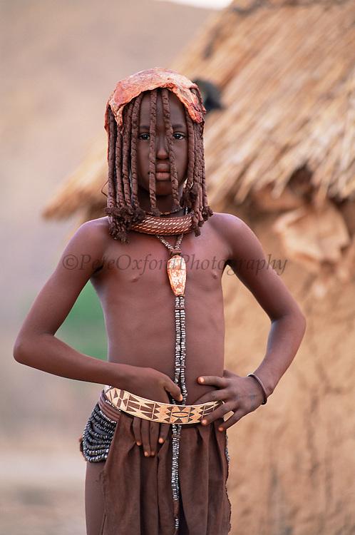 Himba girl Kaokoland, Namibia Hair tresses show adolescence