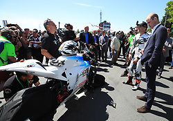 The Duke of Cambridge is shown a bike by motorcyclist Michael Rutter as he attends the Isle of Man TT during his visit to the island.