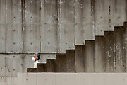 A Japanese man , wearing a surgical face-mask, descends some stairs in Kawasaki, Kanagawa, Japan. Tuesday August 18th 2020