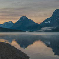 Photographers await the dawn beside Bow Lake in Banff National Park, Alberta, Canada. Behind (L to R) are Mount Andromache, Mount Hector, Bow Peak and Bow Crow Peak.