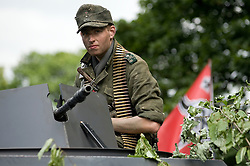 A re-enactor portrays a member of the German elite heer unit GrossDeutschland Panzer Grenadier Division behind an MG34 mounted on a SdkFz 251 Auf C Halftrack at a multiperiod event held in Norfolk Heritage Park Sheffield 29th and 30th Aug 2010 .Images © Paul David Drabble..