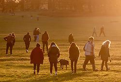 © Licensed to London News Pictures. 20/12/2020. London, UK. On the first day of the latest lockdown restrictions, walkers and families enjoy the sunshine and mild weather in a busy Richmond Park, South West London. Yesterday Prime Minister Boris Johnson put London and parts of the South East into Tier 4 after a Covid-19 mutation spread rapidly thought the Capital. In his address to the Nation last night, he outlined that Christmas is effectively cancelled with all non-essential shops, gyms, and hairdressers close and travelling outside Tier 4 areas, mixing with different households and Christmas bubbles banned after a dramatic rise in infections. Last Wednesday London was put into Tier 3 after the new Covid-19 variant was discovered. Photo credit: Alex Lentati/LNP