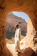 Priest standing in the entrance to Abune Yemata church in the mountains. Near Hawzen Town, Gheralta area, Tigray, Ethiopia, Horn of Africa