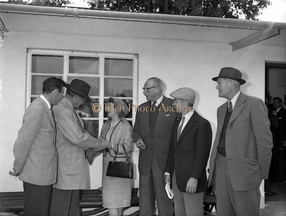 """20/09/1960<br /> 09/20/1960<br /> 20 September 1960<br /> Goffs Bloodstock Sales at Ballsbridge, Dublin. Picture shows: Mrs G.L. Hastings, Friarstown Stud, Co. Limerick who sold two fillys for a total of 13,200 Guineas at the sales. She is being congratulated by: Mr F.W. Burmann, owner of """"Glamour"""" 2nd from left and (l-r) Mr. W. O'Connell, Farm Manager, Friarstown; Major Hastings; Vincent O'Brien and Captain G. Fane."""