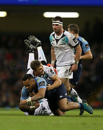 Willis Halaholo of Cardiff Blues is tackled to the ground by Ashley Beck of the Ospreys. Guinness Pro12 rugby match, Judgement day, Cardiff Blues v Ospreys  at the Principality Stadium in Cardiff, South Wales on Saturday 15th April 2017. <br /> pic by Andrew Orchard, Andrew Orchard sports photography.