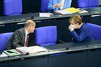 08 DEC 2020, BERLIN/GERMANY:<br /> Angela Merkel (L), CDU, Bundeskanzlerin, und Olaf Scholz, MdB, SPD, Bundesfinanzminister, mit Mundschutz, im Gespraech, Haushaltsdebatte, Plenum, Reichstagsgebaeude, Deuscher Bundestag<br /> IMAGE: 20201208-02-044<br /> KEYWORDS: Mund-Nase-Schutz, Gespräch, Corona, Corvid-19
