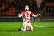 Alfie May of Doncaster Rovers (19) can't believe a free kick wasn't awarded for a tackle on him during the EFL Sky Bet League 1 match between Doncaster Rovers and Sunderland at the Keepmoat Stadium, Doncaster, England on 23 October 2018.