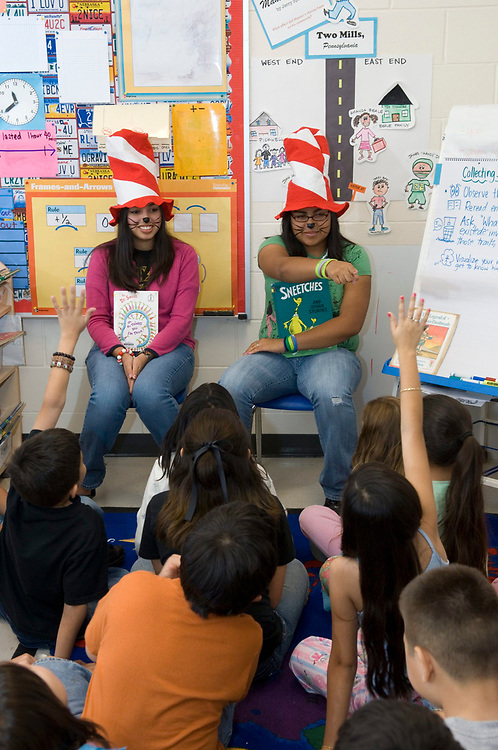 Donna, TX  March 1, 2007: High school seniors read to third graders on Dr. Seuss' birthday at the IDEA Public School, a seven-year old charter school with 1,200 mostly Hispanic students in south Texas.       ©Bob Daemmrich/