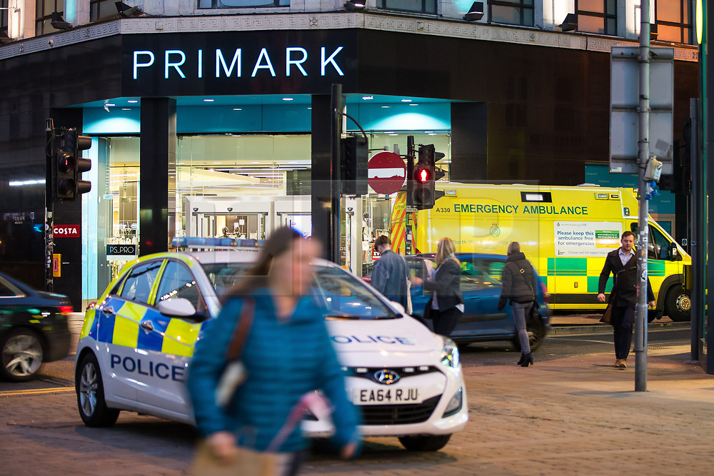 © Licensed to London News Pictures . 07/04/2017 . Manchester , UK . Police and paramedic vehicles on Market Street . Greater Manchester Police have authorised dispersal powers and say they will ban people from the city centre for 48 hours , this evening (7th April 2017) , in order to tackle alcohol and spice abuse . Photo credit : Joel Goodman/LNP