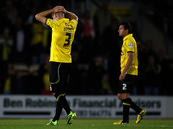 Burton players show their disappointment at the penalty defeat - Photo mandatory by-line: Matt Bunn/JMP - Tel: Mobile: 07966 386802 27/08/2013 - SPORT - FOOTBALL - Pirelli Stadium - Burton - Burton Albion V Fulham -  Capital One Cup - Round 2