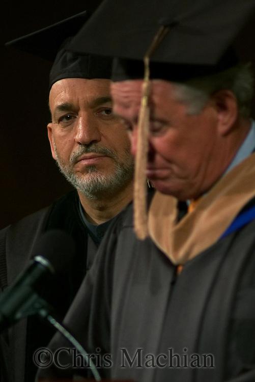 Omaha Neb, 5/25/05  Afghanistan President Hamid Karzai listens to Omaha Mayor Mike Fahey as he gives a speech at the University of Nebraska at Omaha Wednesday evening. (Chris Machian/Prairie Pixel Group)