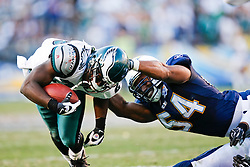 Philadelphia Eagles running back LeSean McCoy #29 is tackled by San Diego Chargers linebacker Stephen Cooper #54 during the NFL game between the Philadelphia Eagles and the San Diego Chargers on November 15th 2009. At Qualcomm Stadium in San Diego, California. (Photo By Brian Garfinkel)