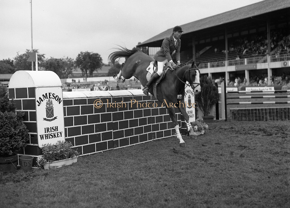 Jameson Whiskey International at the Dublin Horse Show.  (R39).1986..07.08.1986..08.07.1986..7th August 1986..The Jameson Whiskey International at the Dublin Horse Show in the RDS was won by Peter Charles of Great Britain. He rode 'Merrimandias' to victory in the event...Image shows one of the riders in the Jameson Whiskey International clearing the wall aboard his mount at the Horse Show. Jameson's, Irish, Whiskey, jameson,