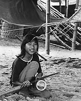 Young vietnamese gir slicing a coconut in Nha Trang, Vietnam.