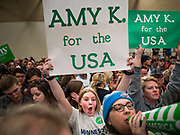 01 MARCH 2020 - ST. LOUIS PARK, MINNESOTA: Supporters of US Senator Amy Klobuchar try to shout down Black Lives Matter protesters who disrupted a Klobuchar rally at St. Louis Park High School. Dozens of Black Lives Matter (BLM) protesters disrupted Sen. Amy Klobuchar's last presidential election rally in Minnesota before Super Tuesday. Almost 500 Klobuchar supporters came to hear Sen. Klobuchar, when the BLM protesters marched into the hall and took control of the stage. Klobuchar cancelled the event about an hour after the BLM protesters entered the hall. The protesters targeted Klobuchar because while she was the Hennepin County Attorney, she oversaw the conviction of Myon Burrell, a black teenager accused and convicted of murder. Evidence has come to light since his conviction that suggests he was wrongly convicted. His conviction has become a flashpoint in Minnesota politics.         PHOTO BY JACK KURTZ