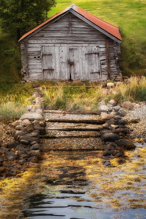 Old boathouse at Eidsdal, Norway. Paint effect added.   Gammelt naust i Eidsdal, Norge. Lagt til malerisk effekt.