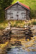 Old boathouse at Eidsdal, Norway. Paint effect added. | Gammelt naust i Eidsdal, Norge. Lagt til malerisk effekt.