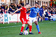 Accrington Stanley midfielder Sean McConville (11) clears  during the EFL Sky Bet League 1 match between Accrington Stanley and Portsmouth at the Fraser Eagle Stadium, Accrington, England on 27 October 2018.