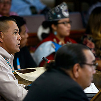 Council delegate Tauchony Slim Jr makes an announcement at the start of the Navajo Nation Council meeting in Window Rock Monday.