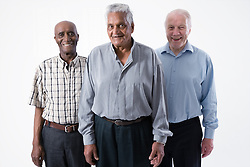 Multiracial group of older men smiling,