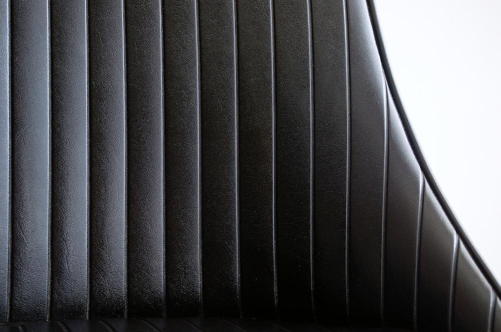 Black, mid-century chair designed by Chromecraft