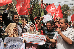 May 1, 2019 - Gaza City, The Gaza Strip, Palestine - Palestinian workers protest in Gaza city against unemployment at International Workers' Day. (Credit Image: © Dawoud Abo Al Kas/Quds Net News via ZUMA Wire)