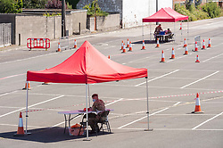 © Licensed to London News Pictures; 27/05/2020; Weston-super-Mare, UK. Soldiers wait for vehicles to arrive at a newly opened mobile test centre staffed by the army in Locking Road car park, to test for coronavirus during the Covid-19 pandemic. Photo credit: Simon Chapman/LNP.