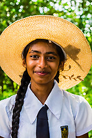 School girls wearing traditional Sri Lanka school uniform with sun hat, Trincomalee, Sri Lanka.