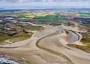 Nederland, Noord-Holland, Texel 07-05-2021;  De Slufter in het Nationaal Park Duinen van Texel, eigendom vanStaatsbosbeheer. Strandvlakte en eenkwelder, staatin open verbinding met deNoordzeeen wordt begrensd door stuifdijken en duinen. Zicht op de Eierlandse polder. De Vlakte van de Slufter wordt ook Sluftervallei genoemd.<br /> De Slufter in the Duinen van Texel National Park. Beach plain and a salt marsh, has an open connection with the North Sea and is bordered by drift dikes and dunes. The Slufter Plain is also called the Slufter Valley.<br /> <br /> aerial photo (additional fee required)<br /> copyright © 2021 foto/photo Siebe Swart