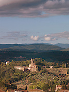 A church in the Tuscan landscape outside of Siena, Italy