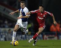 Photo: Jonathan Butler.<br />Blackburn Rovers v Liverpool. The Barclays Premiership. 26/12/2006.<br />David Bentley of Blackburn is held back by Mark Gonzalez of Liverpool.