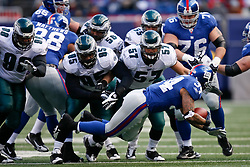 11 Jan 2009: Philadelphia Eagles defense move in on New York Giants running back Derrick Ward #34 during the game against the New York Giants on January 11th, 2009.  The  Eagles won 23-11 at Giants Stadium in East Rutherford, New Jersey. (Photo by Brian Garfinkel)