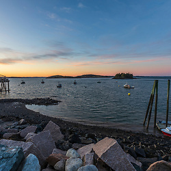 Lobster boats moored in the harbor in Lubec, Maine. Sunset.
