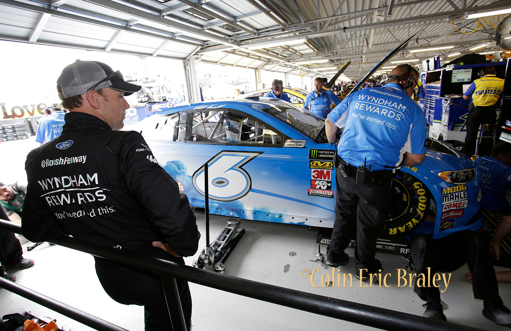 NASCAR Cup Series driver Matt Kenseth stands in the garage following a failed car inspection during a practice round at Kansas Speedway in Kansas City, Kan., Friday, May 11, 2018. (AP Photo/Colin E. Braley)