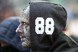 "© Licensed to London News Pictures . 20/10/2018 . Manchester , UK . A man wearing a hoodie with "" 88 "" and with numerous far-right tattoos at the EDL demonstration . 88 is used by far-right groups to stand for HH or Heil Hitler . Hundreds of police contain approximately 50 EDL supporters in Piccadilly Gardens . Street protest movement , the English Defence League ( EDL ) , hold a demonstration , opposed by anti-fascists , including Unite Against Fascism ( UAF ) , in Manchester City Centre . Amongst the reasons for their protest , the EDL cite news reports that revealed an imam at the Didsbury Mosque where Manchester Arena bomber Salman Abedi prayed , praised armed jihad in a sermon delivered just days before Abedi bought a ticket for the Ariana Grande concert at which he killed twenty two people . Photo credit : Joel Goodman/LNP"