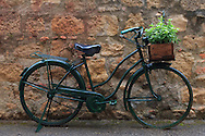 An old-time bycccle placed as an ornament in front of a house in Monticchiello, Orcia Valley, Tuscany