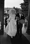 "05/09/1962<br /> 09/05/1962<br /> 05 September 1962<br /> Wedding of Fergus Keogh of ""Eagleville"", Strandville Avenue, Clontarf, Dublin to Miss Miriam Caffrey, Church Avenue, Drumcondra Dublin at the Church of the Visitation of the BVM, Fairview with reception at St. Lawrence Hotel, Howth. Mr. keogh was full-back for Bective Rangers at the time. The bride entering the church."