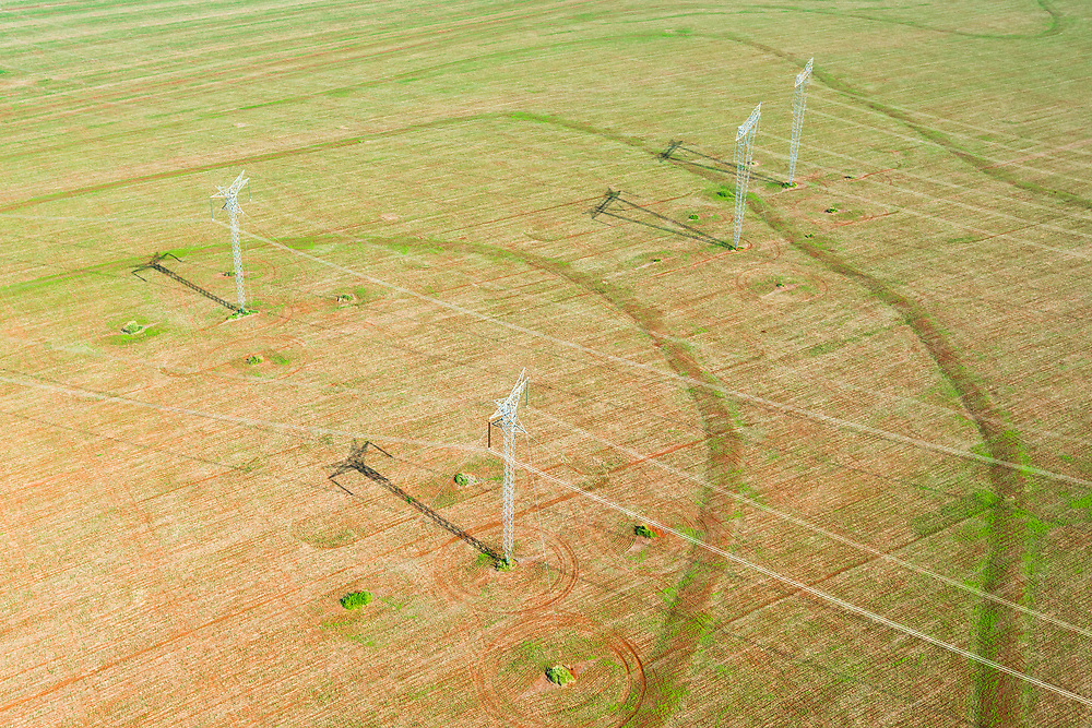Aerial views of power lines through the jungle in Brazil.