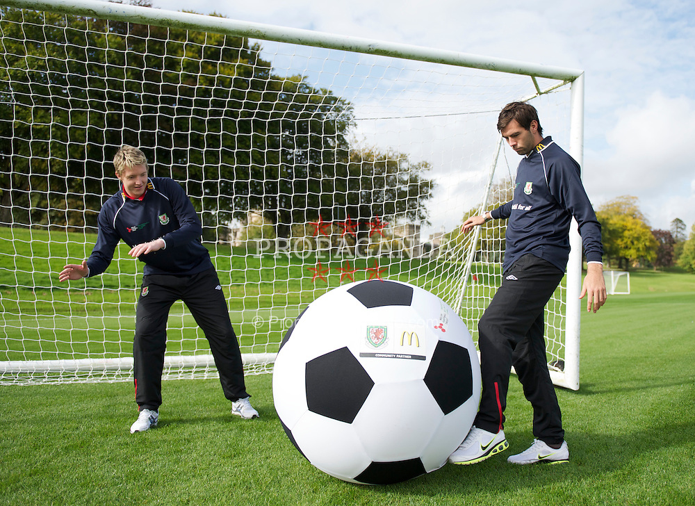 CARDIFF, WALES - Tuesday, October 5, 2010: Wales' goalkeeper Wayne Hennessey and Joe Ledley photographed with a giant McDonald's football to promote the renewall of McDonald's sponsorship of the FAW Trust. (Pic by David Rawcliffe/Propaganda)