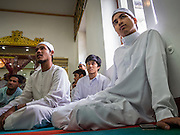 "08 AUGUST 2013 - BANGKOK, THAILAND: Men in the prayer room at Haroon Mosque in Bangkok on Eid al-Fitr. Eid al-Fitr is the ""festival of breaking of the fast,"" it's also called the Lesser Eid. It's an important religious holiday celebrated by Muslims worldwide that marks the end of Ramadan, the Islamic holy month of fasting. The religious Eid is a single day and Muslims are not permitted to fast that day. The holiday celebrates the conclusion of the 29 or 30 days of dawn-to-sunset fasting during the entire month of Ramadan. This is a day when Muslims around the world show a common goal of unity. The date for the start of any lunar Hijri month varies based on the observation of new moon by local religious authorities, so the exact day of celebration varies by locality.      PHOTO BY JACK KURTZ"