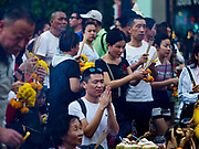 31 DECEMBER 2017 - BANGKOK, THAILAND: People crowd into Erawan Shrine in Bangkok to pray on New Year's eve. Many Thais go to temples and shrines to pray and meditate during New Year's Eve and New Year's Day.    PHOTO BY JACK KURTZ