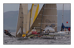 The 2004 Skiff Nationals at Largs held by the SSI.<br /> <br /> Henri Lloyd helmed by Peter Bartoncrosses Radii at the start.<br /> <br /> Marc Turner / PFM Pictures