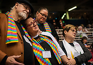 26 FEB. 2019 -- ST. LOUIS -- The Rev. Ed Rowe, left, the Rev. Rebecca Wilson, the Rev. Robin Hager and the Rev. Jill Zundel, react to the defeat of a proposal that would allow LGBT clergy and same-sex marriage within the United Methodist Church at the denomination's 2019 Special Session of the General Conference in St. Louis, Mo., Tuesday, Feb. 26, 2019. America's second-largest Protestant denomination faces a likely fracture as delegates at the crucial meeting move to strengthen bans on same-sex marriage and ordination of LGBT clergy. Photo © copyright 2019 Sid Hastings.