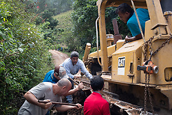 Flooding and landslides across Honduras after hurricanes Eta and Iota washed away and damaged roads. Here a bulldozer, sent in to repair a road, broke down causing a roadblock for a day.