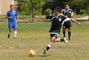 Fabian Lopez (#16) of Deportivo Colomex winds up while competing with Team Shlama F.C. during National Soccer League play in Skokie, Il.  .
