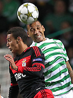 Football - Champions League - Celtic vs.Celtic vs. Benfica<br /> <br /> Rodrigo of Benfica competes with Kelvin Wilson of Celtic during the Celtic vs. Benfica  Champions League Group G match at Celtic Park on September 19th 2012.<br />  <br /> Colorsport