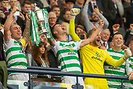 Celtic are Treble Treble Winners! Club Captain Scott Brown, Mikael Lustig, Scott Bain, Callum McGregor lift the Scottish CUp Trophy following their 2-1 win over Hearts in the William Hill Scottish Cup Final match between Heart of Midlothian and Celtic at Hampden Park, Glasgow, United Kingdom on 25 May 2019.